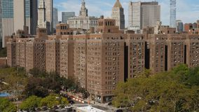 Day High Angle Establishing Shot of Brick Manhattan Apartments. 9374 A daytime sunny exterior establishing shot (DX) of typical red brick apartment buildings in stock video footage
