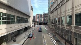 Day High Angle View of Downtown Pittsburgh City Street. A daytime high angle view of a downtown Pittsburgh city street on a sunny winter day stock footage