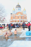 The Day of Holy Manifestation, Dnipro river, Kiev, Ukraine, January 19, 2016. Many unidentified people plunging into ice water. Ol Royalty Free Stock Images