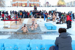 The Day of Holy Manifestation, Dnipro river, Kiev, Ukraine, January 19, 2016. Many unidentified people plunging into ice water. Ol Royalty Free Stock Photo