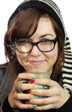 Day 313 (Jan 7) – Willow. Willow wearing glasses holding steaming cup of coffee or tea, with winter hat and painted fingernails royalty free stock photo