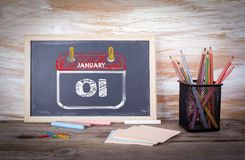 Day 1 of january month. Old wooden table with texture.  Royalty Free Stock Images