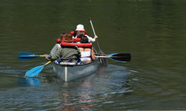 A day on the lake. Family heads out in their canoe stock photos