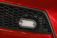 Day led lights. Driving day LED lights at red car stock images