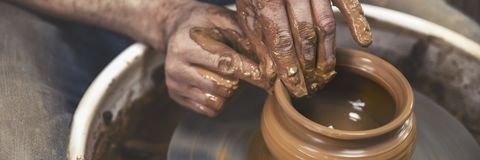 A day in the life of a pottery artist - at the pottery wheel. royalty free stock photo