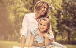 Day with mom. Happy mother and daughter in public park. Close up royalty free stock image