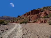 Day moon. Over rad canyon near Tupiza in Bolivia Royalty Free Stock Image