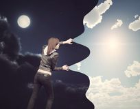 Day after night. Girl catch the sky Stock Photo