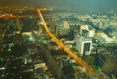 Day and night change in a big city. Combined image of day and night aerial view of Bangkok downtown. Thailand Royalty Free Stock Photos