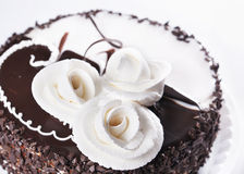 Day And Night chocolate cake with cream roses Royalty Free Stock Images