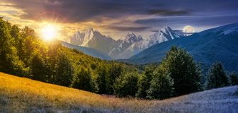 Day and night composite of mountainous landscape Royalty Free Stock Images