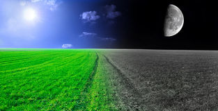 Day and night conceptual image. Green field in day and night Stock Image