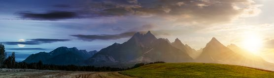 Day and night over rural area in Tatra Mountains. Day and night time change concept over rural area in Tatra Mountains. beautiful panorama of agricultural area Stock Image