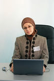 Day in office. Muslim business woman with notebook in office Stock Images