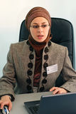 Day in office. Muslim business woman with notebook in office Royalty Free Stock Images