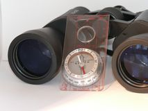 Day out hiking. Black binoculars with a compass Stock Image