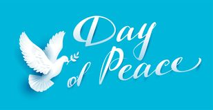 Day of Peace lettering text for greeting card. White dove with branch symbol of peace Stock Photography