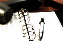 Day Planner 2. Photo of a Day Planer, Pen and Phone With Color and Blur Effect Royalty Free Stock Photos
