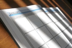 Day Planner. Open at January on a wooden desk Royalty Free Stock Photos