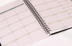 Day Planner. Day planer opened up to a calendar Stock Images