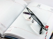 Day planner with glasses Royalty Free Stock Photos