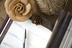 The day on planner page open. With flower and pen Stock Images