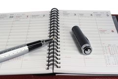 Day planner & pen - 2. Open day planner with a pen Royalty Free Stock Photography
