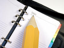 Day Planner with Pencil. Open day planner with a huge pencil pointing to TODAY Royalty Free Stock Photography