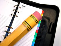Day Planner & Pencil. Huge pencil on an open day planner Stock Photography