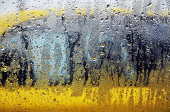 Day of rain. A yellow cab seen from an other, a day of heavy rain stock image