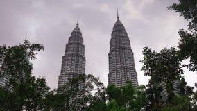 Day rainy sky kuala lumpur famous petronas twin towers tops 4k time lapse malaisia stock video