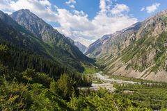 Day in ravine. Beautiful landscape in mountains mountains, ske, clouds Stock Image