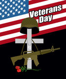 Day of remembrance for war veterans. Veterans Day. Cross with  s. Oldiers helmet and  machine gun. Fallen soldiers grave with flowers. Day of mourning and memory Stock Images
