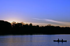 Day's End. Couple fishing at dusk royalty free stock photography