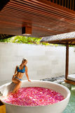 Day Spa Body Care. Woman Relaxing Near Flower Bath Outdoors Stock Photography