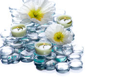 Day Spa with flowers candles. In a zen setting isolated on white Royalty Free Stock Photo