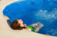Day spa outdoor woman relaxed on blue pool. Water Stock Photos
