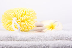 Day Spa Pamper Items. Day spa beauty pamper products on white towel stock images