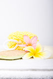Day Spa Pamper Items. Day spa beauty pamper products on white towel royalty free stock photo