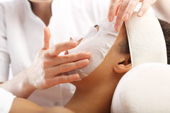Day spa salon. face mask Royalty Free Stock Photo
