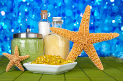 Day Spa Still-life With Starfish. Day Spa Still-life With Bath Beads, Sea Salt and Starfish On Green Bamboo Mat Royalty Free Stock Photos