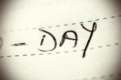 Day spelled on lined paper Stock Images