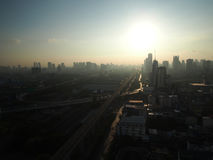 The day start with the shining of the sunlight in the morning of. The shadow is fading while the sun is rising up in the middle of Bangkok city, Thailand Royalty Free Stock Image