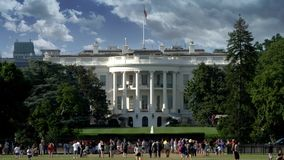 Day Sunny Exterior of The White House. 8978 WASHINGTON, D.C. - Circa August, 2017 - A sunny daytime exterior establishing shot of The White House with tourists stock video footage