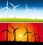 Day and Sunset windmills Royalty Free Stock Image