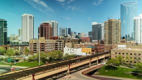 Day time lapse of city skyline and elevated train traffic on Lake Street, Chicago.