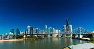Day time panorama of Brisbane city with Story Bridge and ferries stock video footage