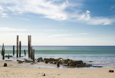 Day-Time at Port Willunga Beach Jetty Ruins, Fleurieu, SA. Port Willunga Beach featuring the iconic jetty ruins in the day light with slow shutter speed Royalty Free Stock Images