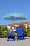 In day-time on sand chairs cost under umbrella Stock Photography