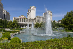 A day time view of Caesars Palace with fountains. Stock Image